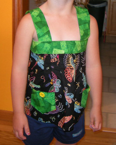 This is my 4 year old niece, Jade. Shes rocking the Spring Ruffle Top, with bugs. I had to adjust this pattern a bit for kids - made the straps 1.5in instead of 2.5in etc. I also skipped the ruffles because shes not really a ruffle girl. Theres bugs on her shirt!