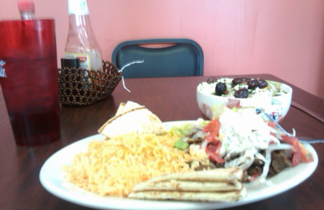 Doner Kebab Plate, with yellow rice, bread, a Greek salad and sweet tea.