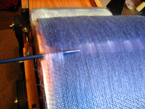 Starting to pull roving from drum carder