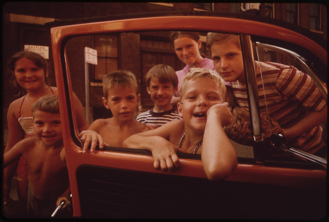 "Youngsters in ""Over the Rhine"" Residential Neighborhood North of the Business District. They Want the Photographer to Take ""Just One More"" Picture 09/1973"