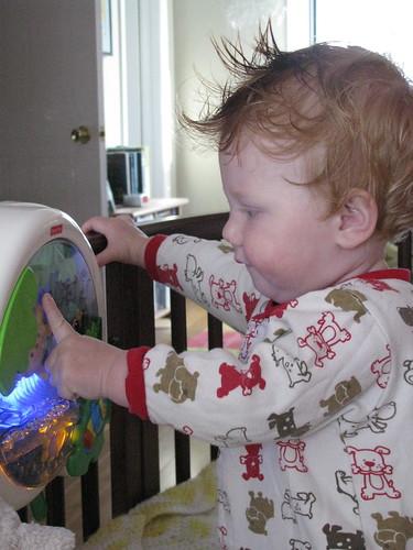 Rainforest toy in crib