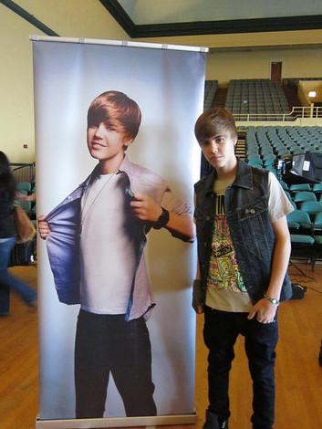 Justin Bieber and Power Balance Silicone Bracelet Photograph by epfitness.com
