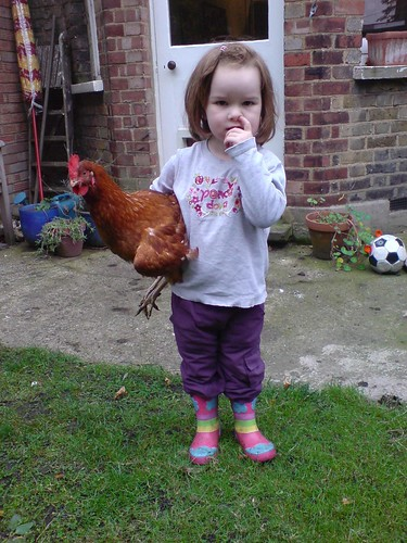 Holding chicken and picking nose