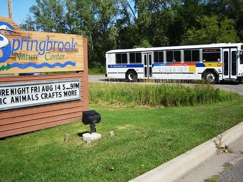 Express bus drops off at park entrance.