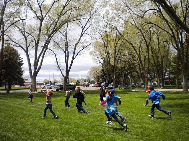 Second grade children running across the Main Park, Elko Nevada