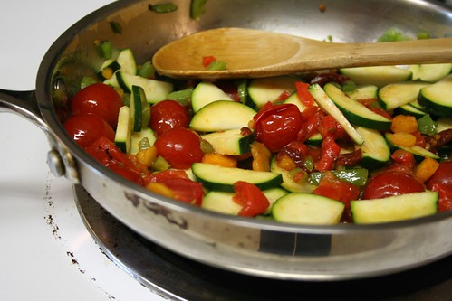 Sauteing vegetables for rice and beans