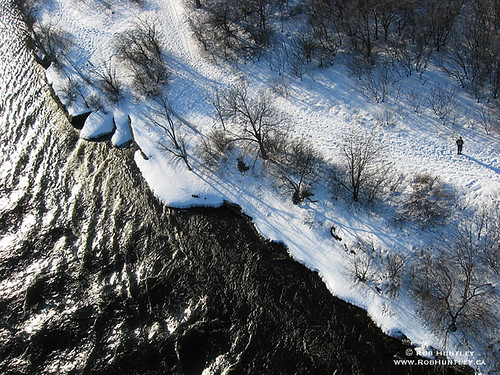 Overhead view of the rugged shoreline in winter at Deschenes Rapids near Aylmer, Quebec.
