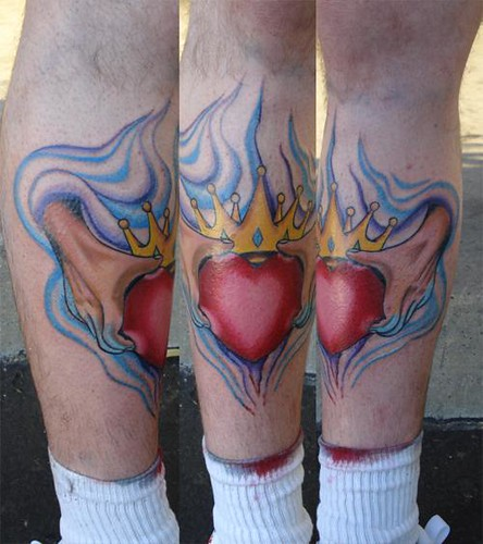Claddagh tattoo ands holding heart