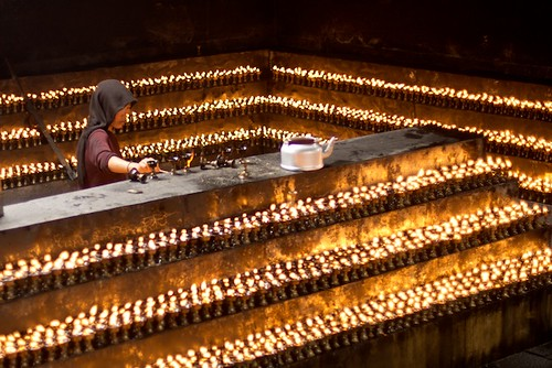 Tibetan Nun Lighting Butter Candles