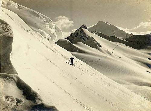 Skier traveling past Coleman Creek and Camp Kizer, Mount Baker