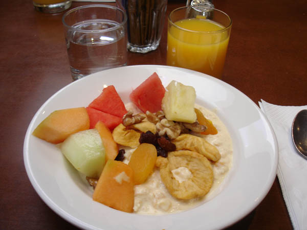 Zipp Restaurant Bar (Mantra hotel, Canberra) - Porridge (way too sweet), dried fruit, nuts and fresh fruit.