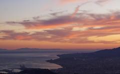 Ciudad de Malaga al atardecer con los Montes d...