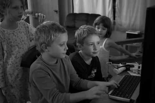 Girls watching boys watching screens