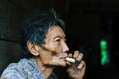 Mentawai man smoking
