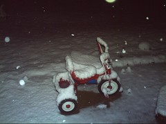 Toys nearly covered completely in snow
