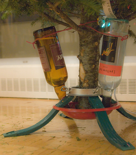 A more elegant solution would have been to utilize a siphon and have the wine bottles hanging from the tree as ornaments...maybe next year...