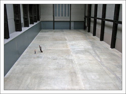 Image of a man and a child playing inside a big indoor space