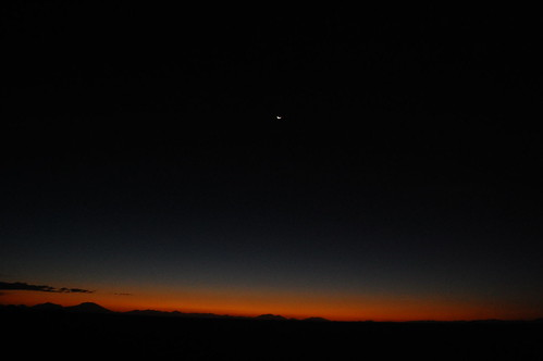 End of the sunset and the moon over the Salt Flats
