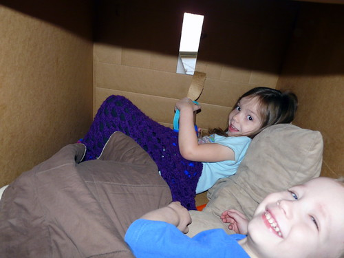 Landon and Em play in a box