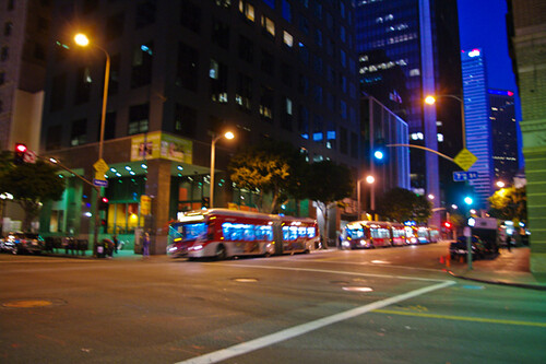 Metro Rapid buses wait for Blue Line passengers outside of 7th Street Metro Center.