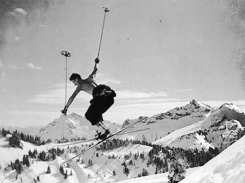 Skier making a cornice jump near Edith Creek, Mount Rainier