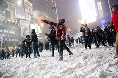 Snowstorm and snowball fight in Times Square, ...