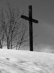 cross on a snowy hill - b/w