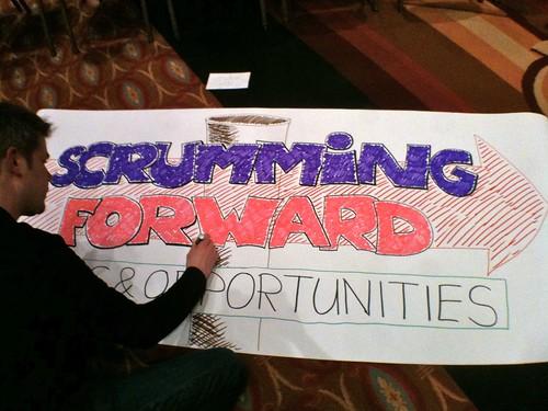 Scrumming forward - open space banner @ Scrum Gathering