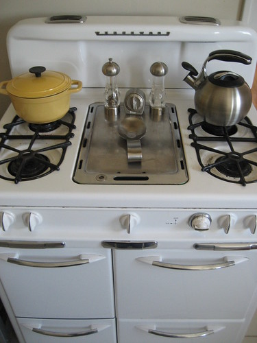 stovetop with pot and tea kettle