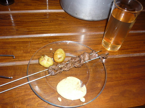 Typical plate: Anticuchos, potatoes, and peanut sauce