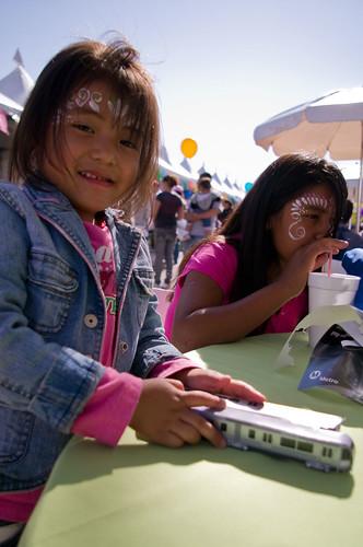 At the East L.A. farmers market kids had fun building paper Metro light rail vehicles.
