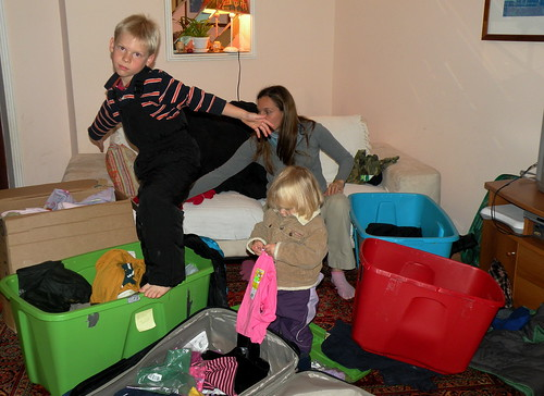 Nadia receives help from kids in sorting through the winter clothes