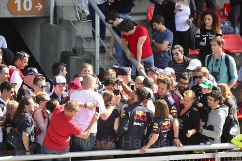 Daniel Ricciardo poses for photos in the crowd during Formula One Winter Testing 2017