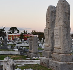 Streetcar glides by the cemetery