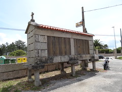Galician hórreo - typical granary (storage) raised on pillars - always with a cross in Galicia