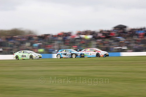 Rob Austin, Aiden Moffat and Tom Ingram in race one at the British Touring Car Championship 2017 at Donington Park