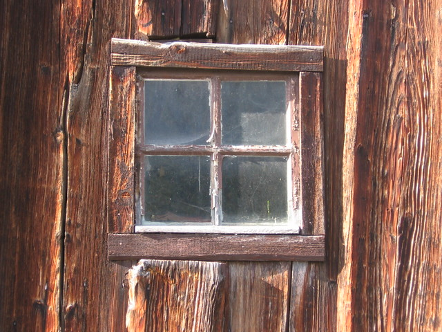 Rustic window  For admitting a moderate amount of light