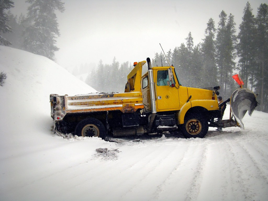 Snow Plow Truck stuck off road on snowy teton pass
