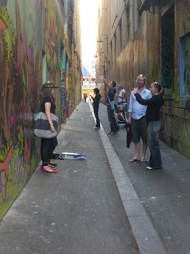 Tourists taking photos in Union Lane, Melbourne - Street Art Permit STA015