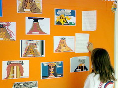 Students use KidPix to create diagrams of their studies of volcanos.