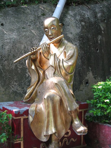 Buddha playing a wind instrument