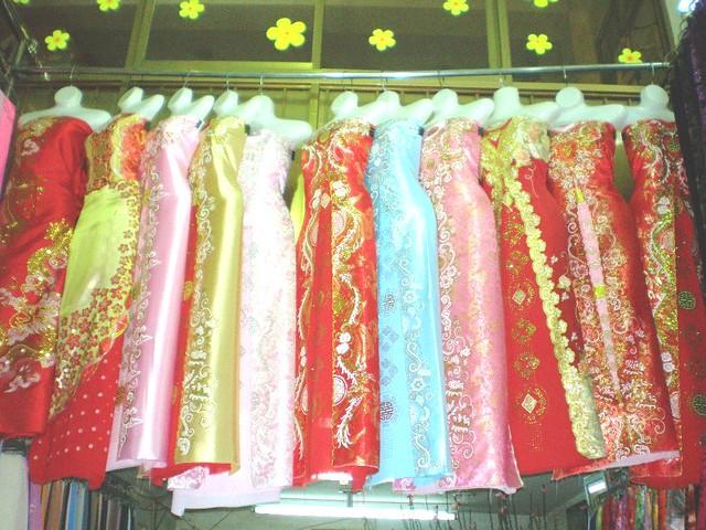 Vietnamese long dresses in a window