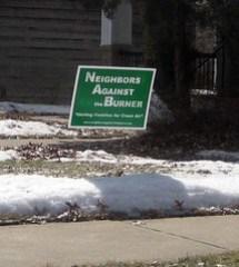neighbors against the burner sign
