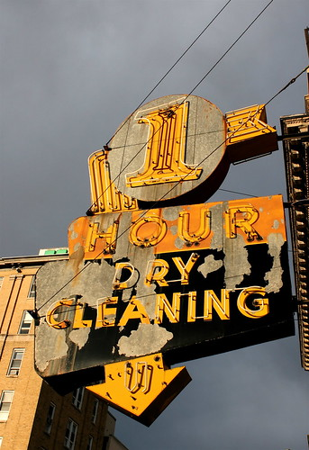 Neon dry-cleaning sign against stormy skies in Bexley, WV. Photo copyright Jen Baker/Liberty Images; all rights reserved