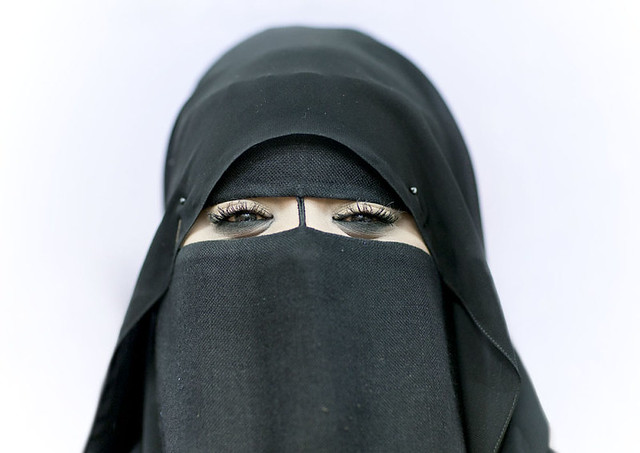 Miss Mouna smiling under her veil, Salalah, Oman