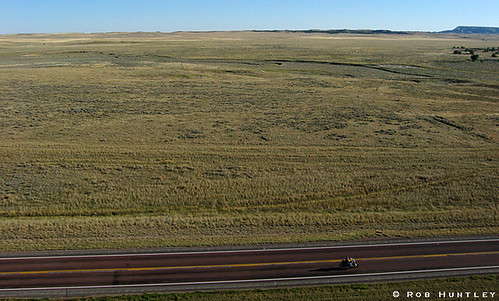 Easy rider. Motorcycle cruising through the vastness of Wyoming.