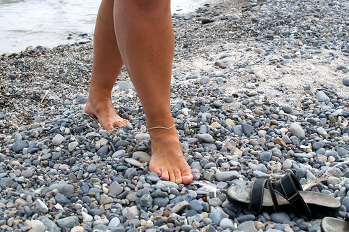Feet on pebble beach