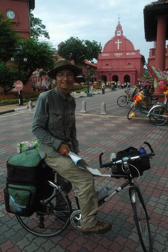 Chin on his 10 country cycling tour, standing infront of the church in Melacca!