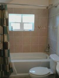 Fiberglass or tile tub surround DIY??