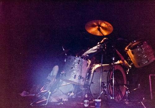 Kurt Cobain in a drumkit, as he was inclined to do from time to time